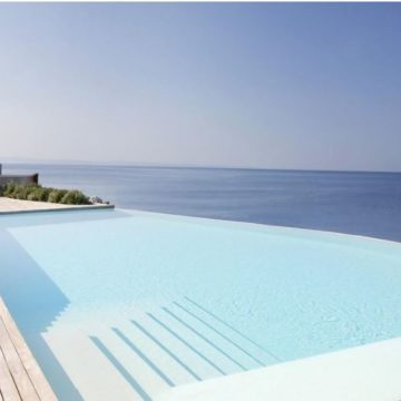 Falisia Resort & Spa Portopiccolo's picturesque infinity pool on a hot summer day.