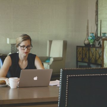 a female hotel manager working at her desk on a laptop