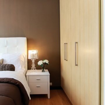 a hotel room in a neutral colour palette