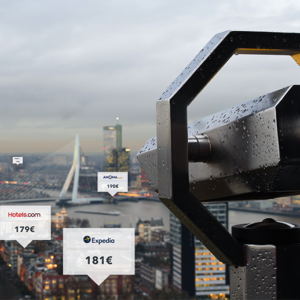 A tower viewer looks out onto a cityscape with different booking site rates hovering over hotels