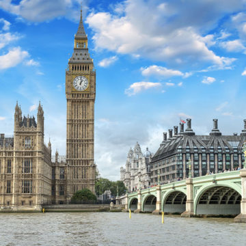 Big ben stands tall behind a view of the Thames