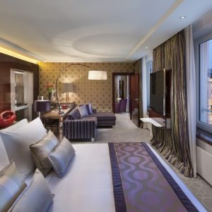 interior design hotel suite with purple and silver colour scheme