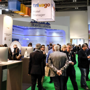 trivago stand at WTM london with many hoteliers in front
