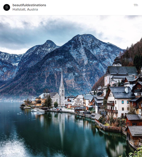 A lakeside town surrounded by mountains