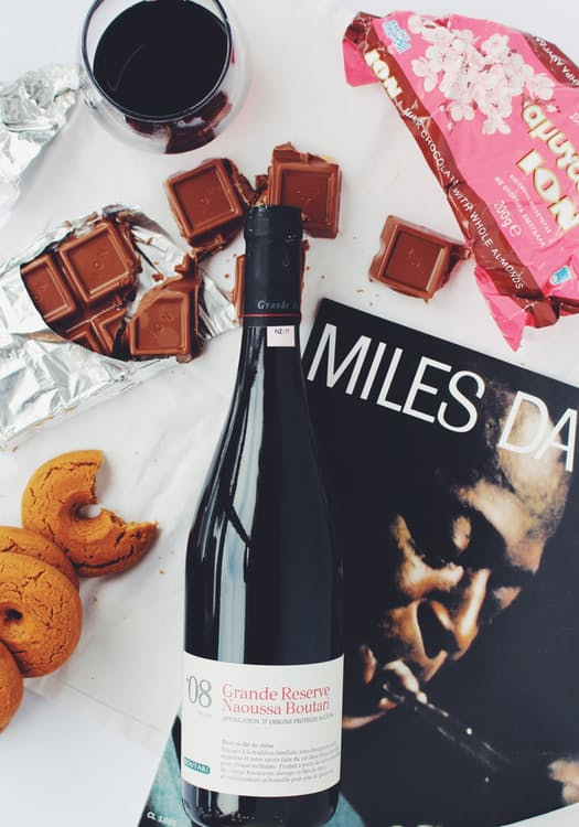 chocolate, wine, cookies and a magazine for guests
