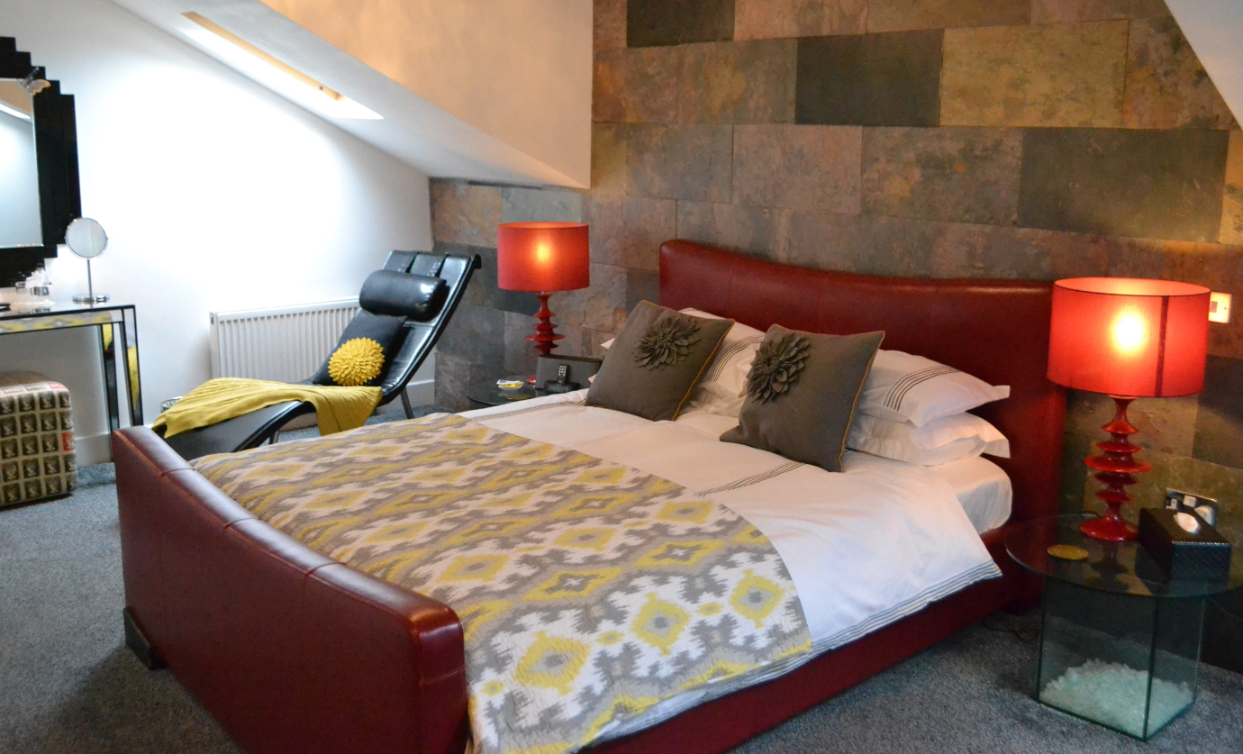 The Arthington Guest House with a red bed