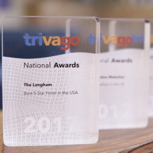 3 trivago Awards on a desk