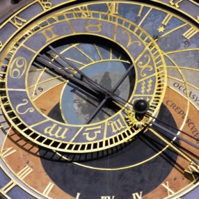 A sundial in gold and navy blue is turning
