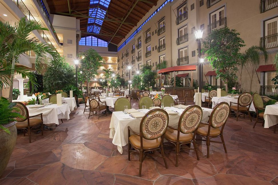 Woolley's Classic Suites manages their online reputation by uploading beautiful photos of their hotel atrium