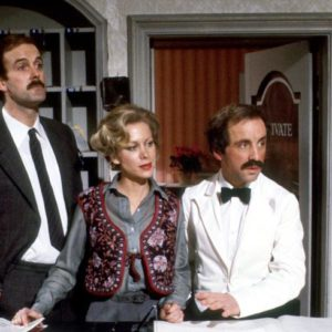 The fictitious Fawlty Towers hotel reception and management team