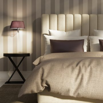 A hotel room concept with plush, high-quality linens attracts guests