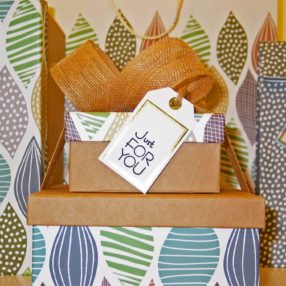 "Colorfully wrapped gift boxes with the tag ""just for you"" indicating exclusivity"