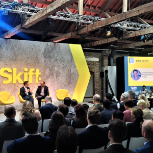 trivago Managing Director Johannes Thomas onstage with Skift giving an interview on the status of, and how hoteliers can increase, direct bookings