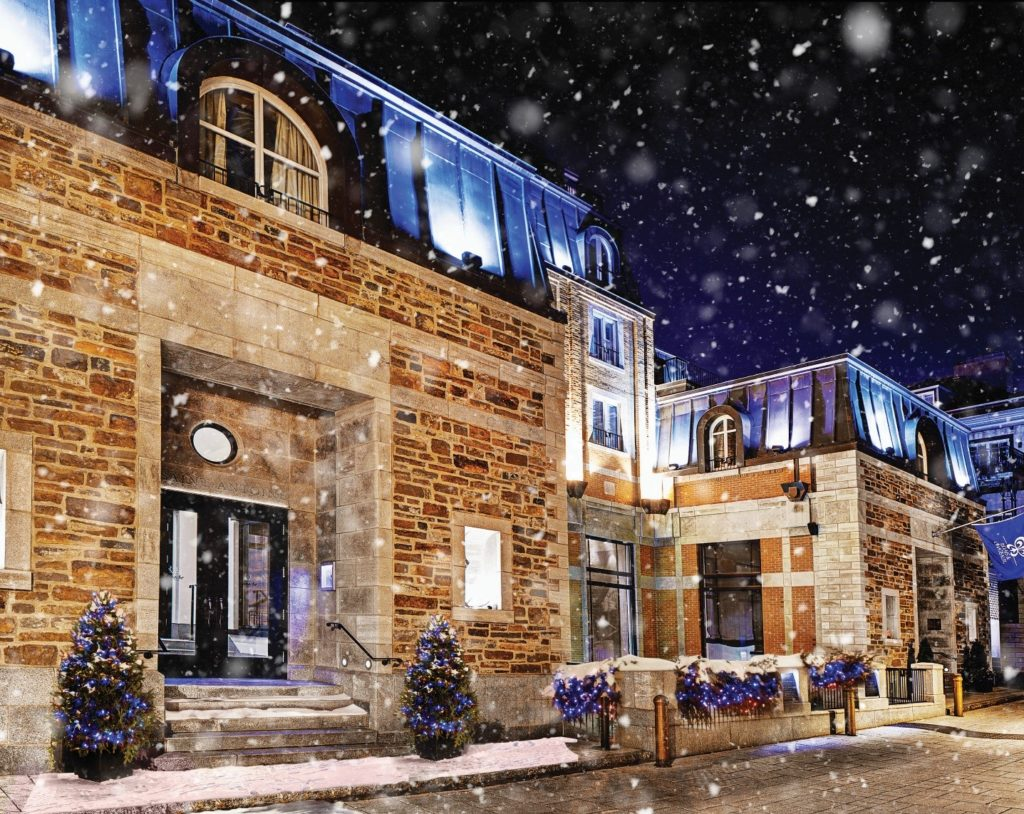 Snow falling outside Auberge Saint Antoine in Quebec City