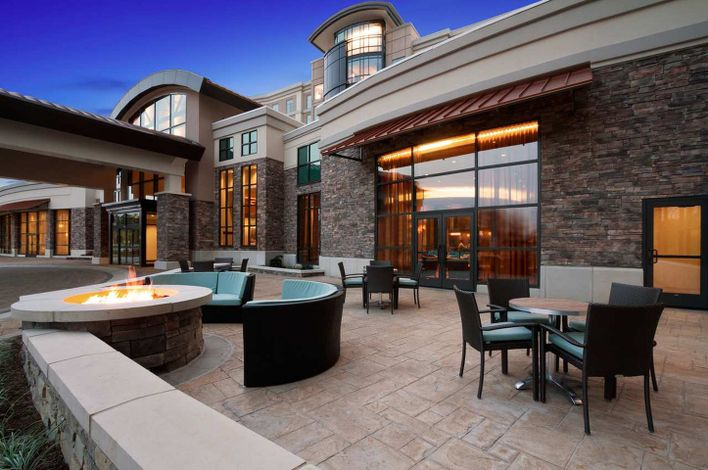 An outdoor seating area at Embassy Suites by Hilton Springfield