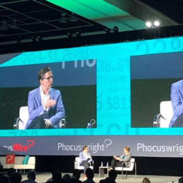 Johannes Thomas di trivago sul palco con la Director of Research di Phocuswright, Maggie Rauch