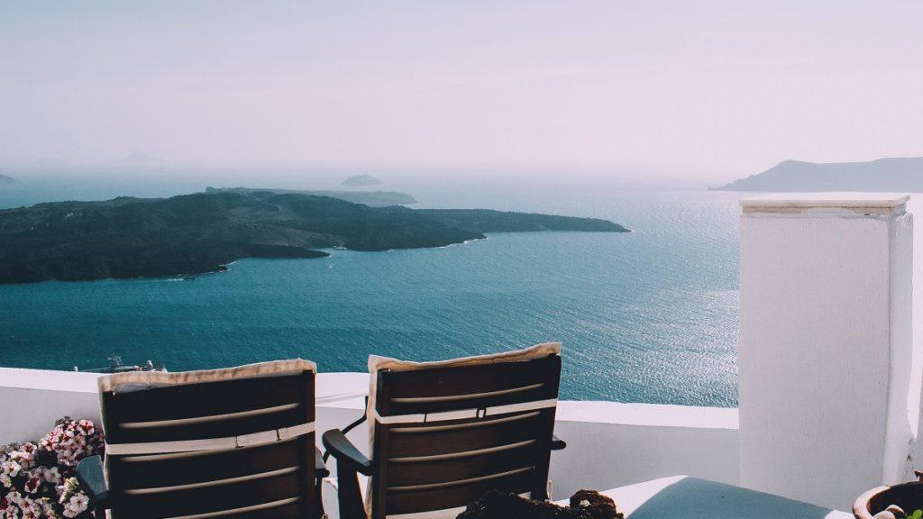 a Greek hotel balcony over the sea