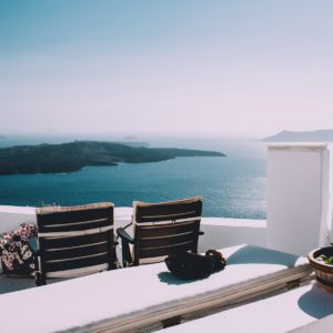 a Greek hotel balcony over the sea