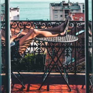 A loyal hotel guest on the balcony of her favorite hotel